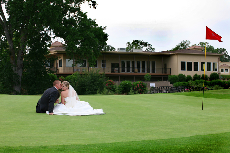 A newlywed couple sits on one of the course's greens at La Contenta Golf Club
